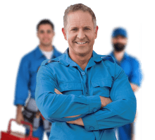 Workman standing and smiling